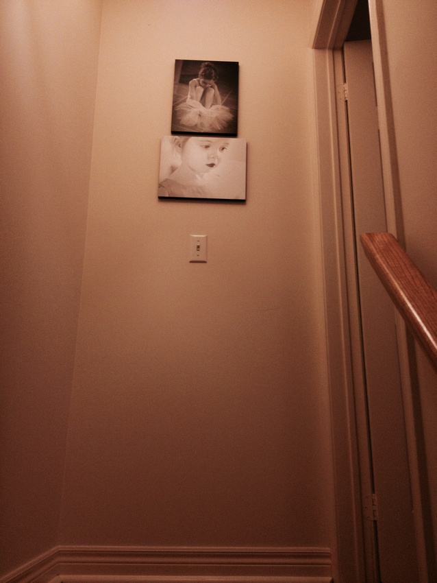 Standout mounted prints outside of bedroom
